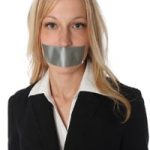 prosecutor with tape over her mouth so she cannot go against plea deal